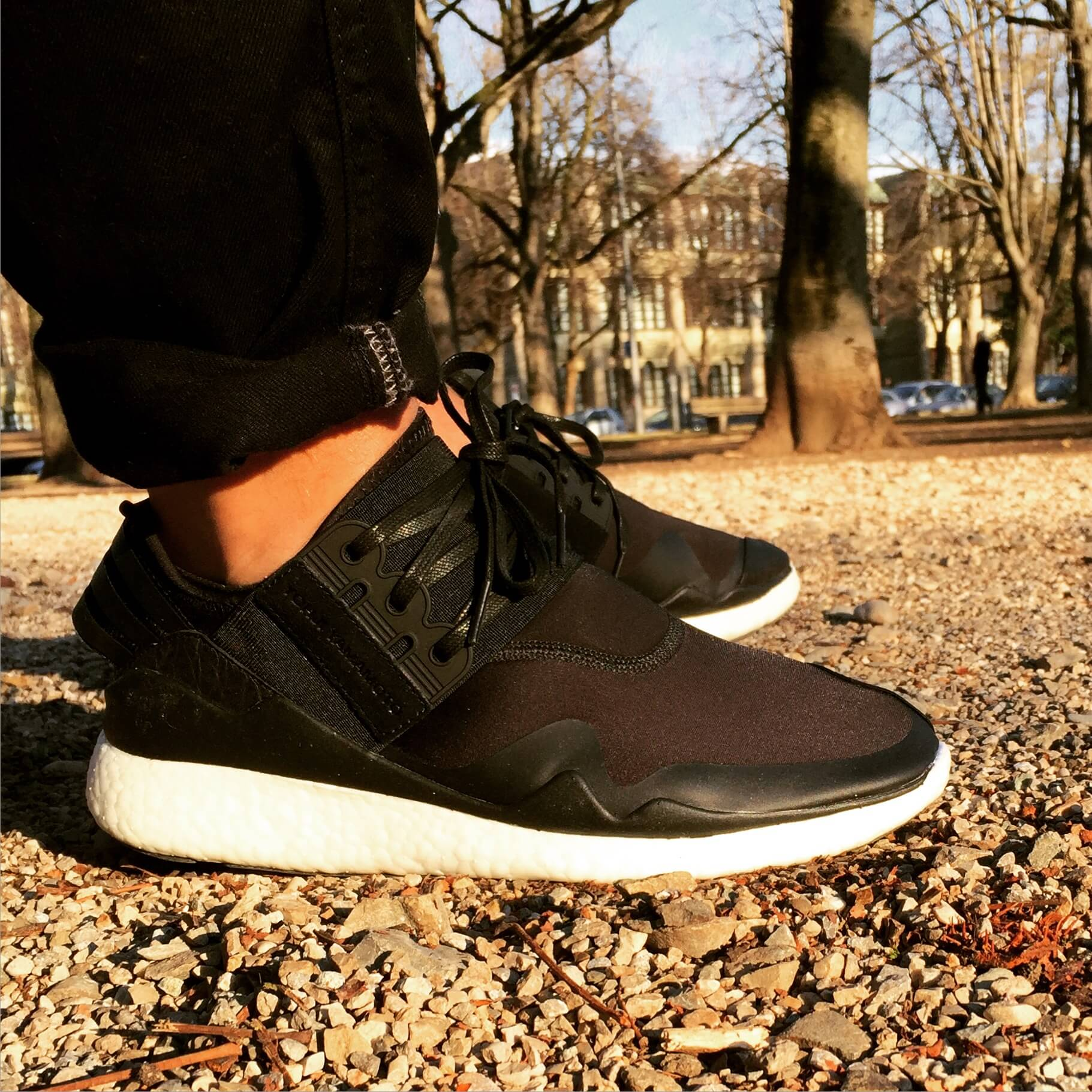 Y-3-Retro-Boost-Triple-Black-Side-View-Benstah-Onfeet